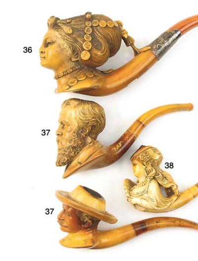 Two Meerschaum pipes modelled