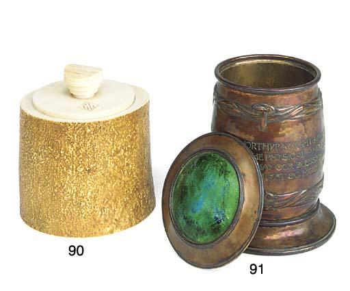 An Art Nouveau brass and ename