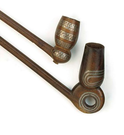A group of five Zulu wood pipe