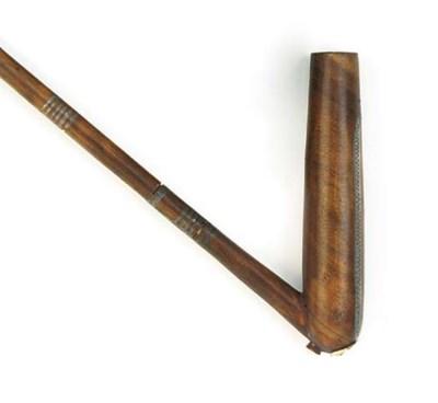 Eight Zulu wood pipes