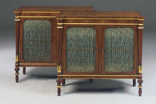 A pair of rosewood and gilt de