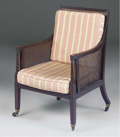 A mahogany and caned bergere