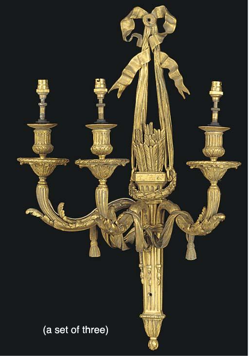 A set of three gilt bronze thr