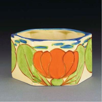 An Orange Lily Eve Fern Pot