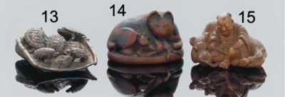 A Japanese wooden netsuke of a