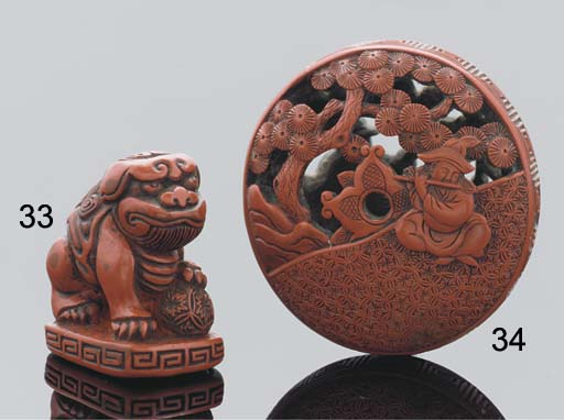 A Japanese red lacquer manju n