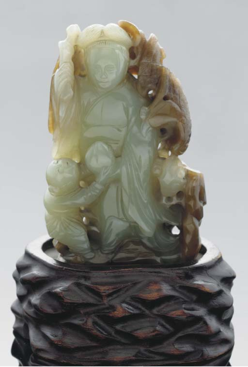 A pale celadon and brown jadei