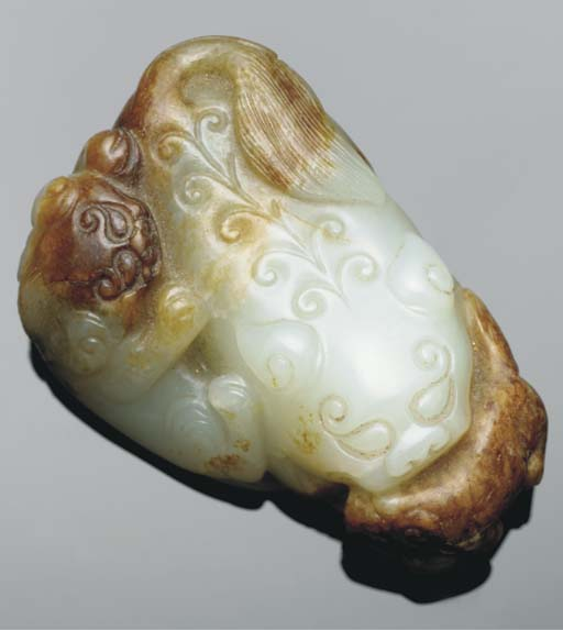 A Chinese mottled celadon jade