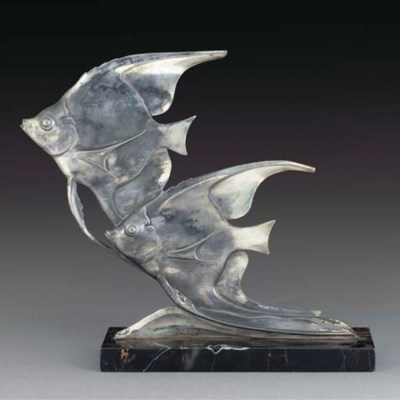 A silvered spelter figural gro