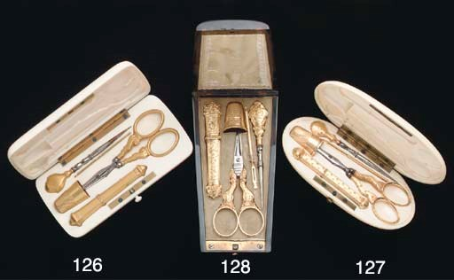 An ivory cased silver-gilt sew