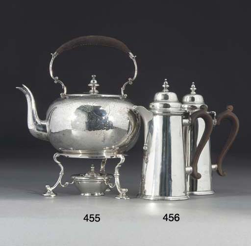 A PAIR OF SILVER HOT WATER JUG