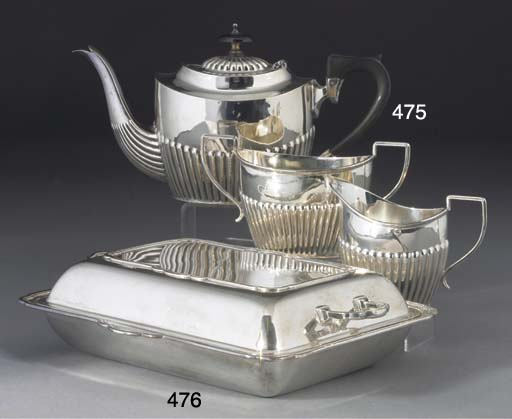 AN EDWARDIAN THREE-PIECE SILVE