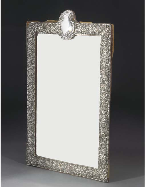 A SILVER MOUTED DRESSING TABLE