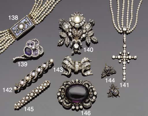 A Victorian diamond bow brooch