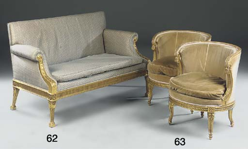 A pair of giltwood bergeres