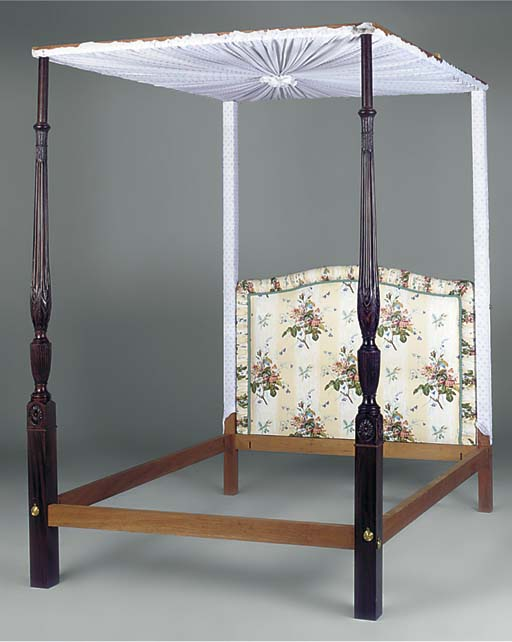 A FOUR POSTER BEDSTEAD