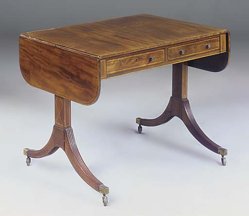 A mahogany and inlaid sofa tab