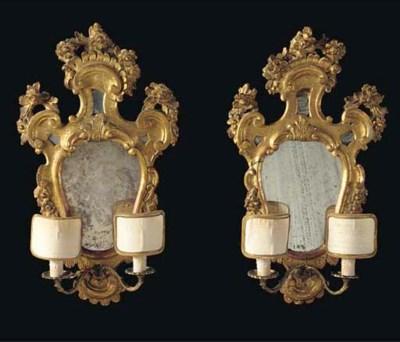 A pair of Venetian giltwood gi