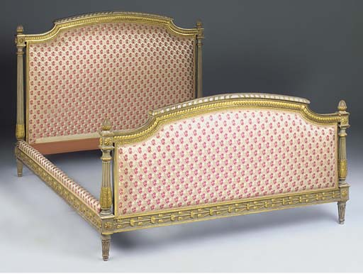 A French painted and parcel gilt bed