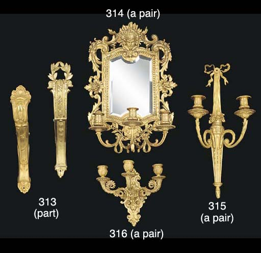 A set of four gilt metal curtain rail supports