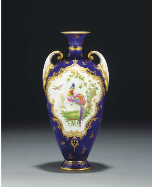 A pair of Royal Worcester dark-blue-ground two-handled oviform vases