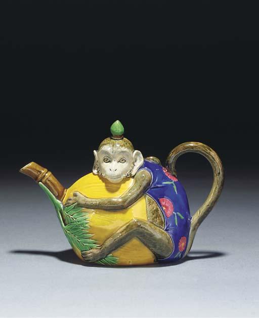 A Minton majolica teapot and c