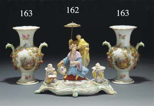 A pair of Meissen encrusted va