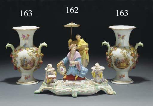 A pair of Meissen encrusted vases