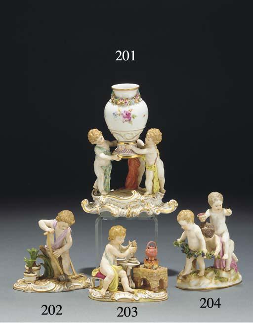 A Meissen urn supported by thr