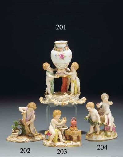 A Meissen urn supported by thr