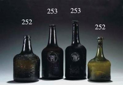 Two sealed cylindrical wine-bo