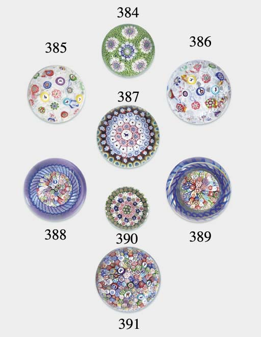 A Baccarat signed and dated scattered millefiori weight