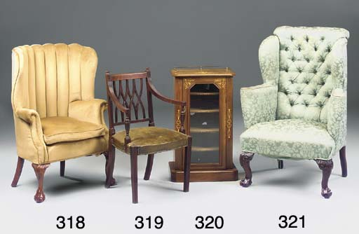 A walnut and upholsterd wing a