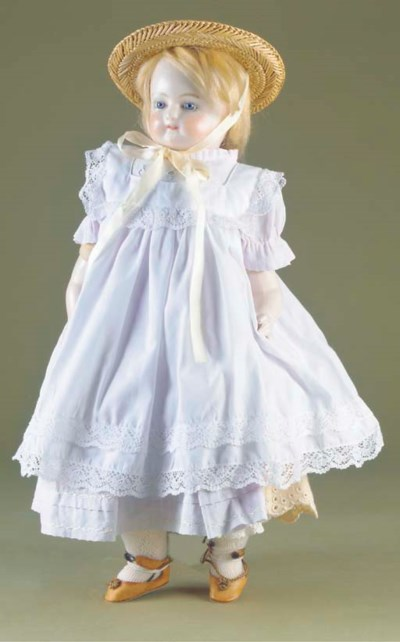 A dipped wax child doll