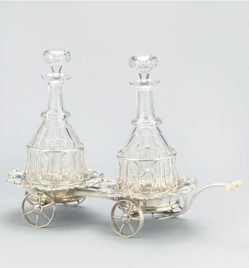 A SILVER-PLATE DOUBLE DECANTER