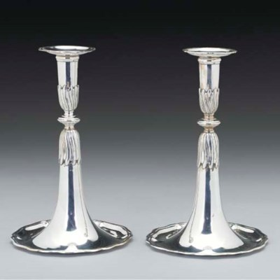 A pair of Swiss Silver Candles