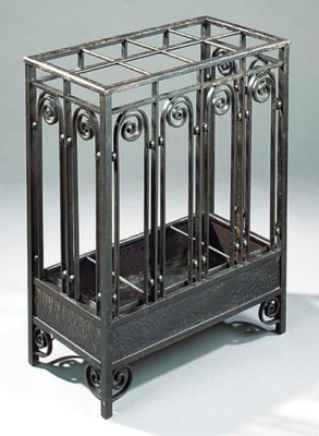 AN ART DECO WROUGHT AND CAST I