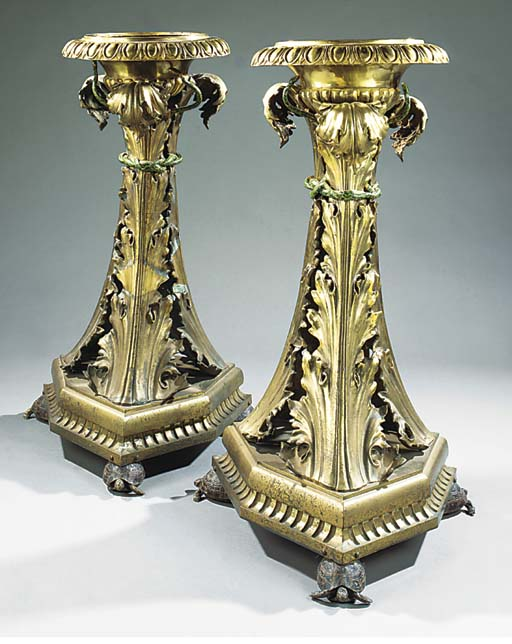 A PAIR OF BRASS STANDS