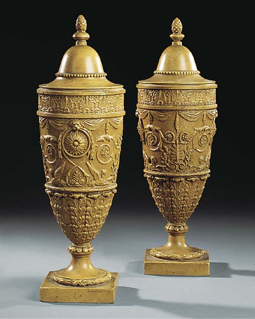 A PAIR OF CARVED WOOD AND GESS