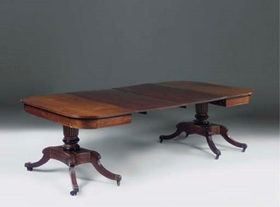 A REGENCY MAHOGANY TWIN-PEDEST