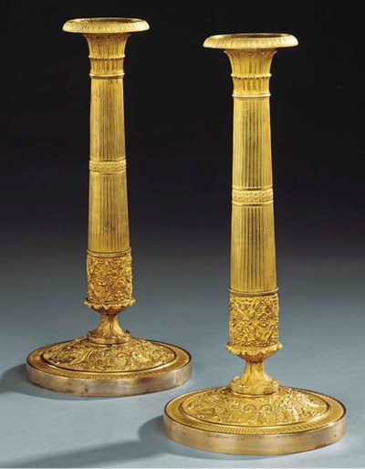 A PAIR OF EMPIRE ORMOLU CANDLE