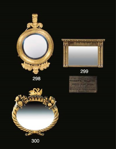 A GILTWOOD AND EBONISED OVAL W