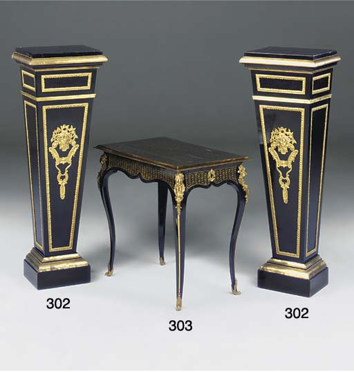 A PAIR OF EBONISED AND GILT ME