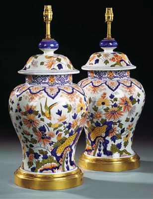 A PAIR OF GLAZED CERAMIC TABLE