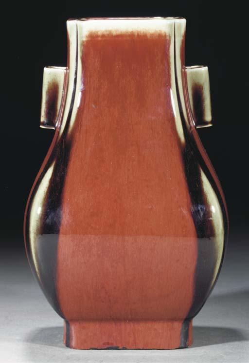 A flambe glazed vase, incised