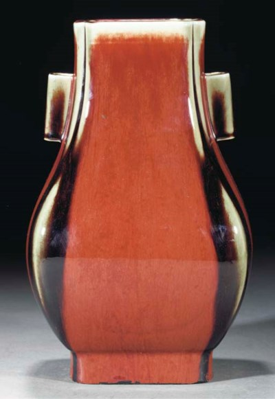 A flambe glazed vase, incised