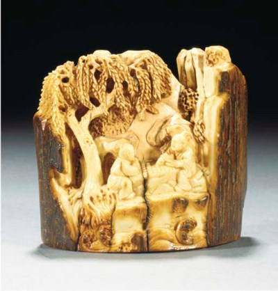 A mammoth tooth carved group,