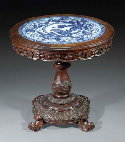 A circular hardwood table with