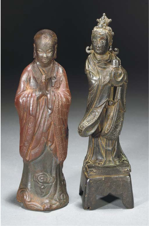 A bronze model of a female att
