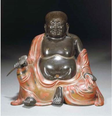 A bronze model of Budai, 17th/